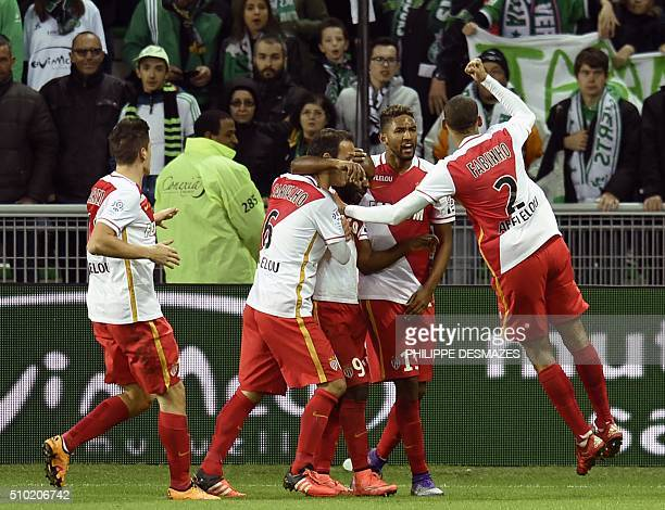 Monaco's Brazilian forward Vagner Love is congratuled by teamamtes after scoring a goal during the French Ligue1 football match between AS...