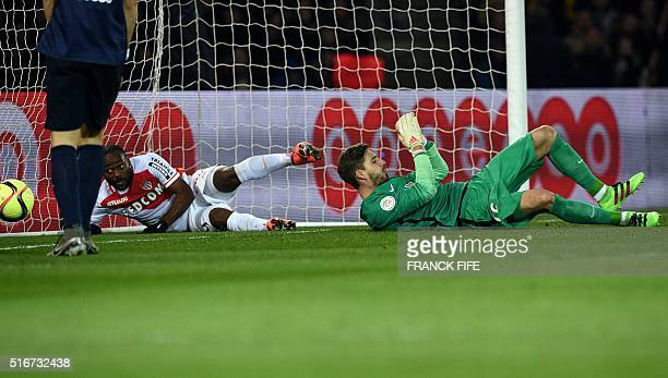 Monaco's Brazilian forward Vagner Love reacts next to Paris SaintGermain's German goalkeeper Kevin Trapp after scoring a goal during the French L1...