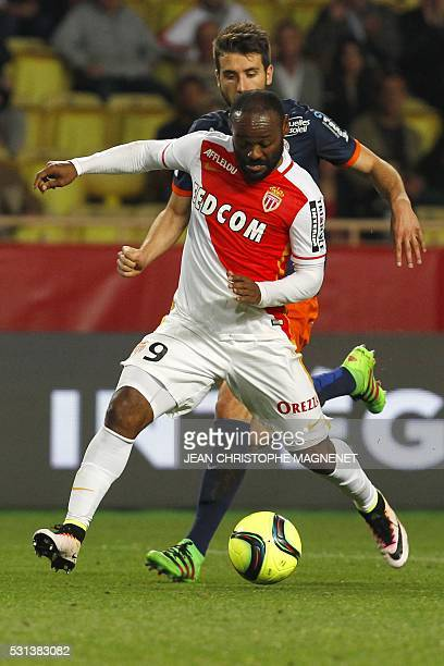 Monaco's Brazilian forward Vagner Love vies with Montpellier's French defender Mathieu Deplagne during the French L1 football match Monaco vs...