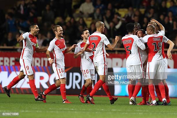 Monaco's Brazilian mildfielder Gabriel Boschilia celebrates with teammates after scoring a goal during the French L1 football match Monaco vs...