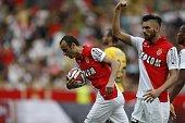 Monaco's Bulgarian forward Dimitar Berbatov grabs the ball as Monaco's Belgian midfielder Yannick Ferreira Carrasco reacts after Berbatov scored a...