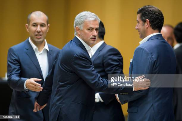 Monaco's coach Leonardo Jardim Manchester United manager Jose Mourinho and Benfica coach Rui Vitoria all from Portugal react after a session of the...
