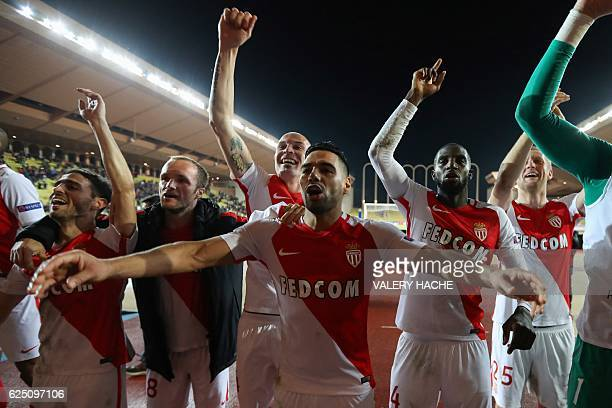 Monaco's Colombian forward Radamel Falcao and his teammates celebrate after winning the UEFA Champions League group E football match AS Monaco and...