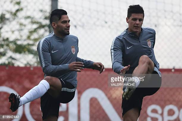 Monaco's Colombian forward Radamel Falcao and Monaco's Argentinian forward Guido Carrillo take part in a training session at the 'Louis II Stadium'...