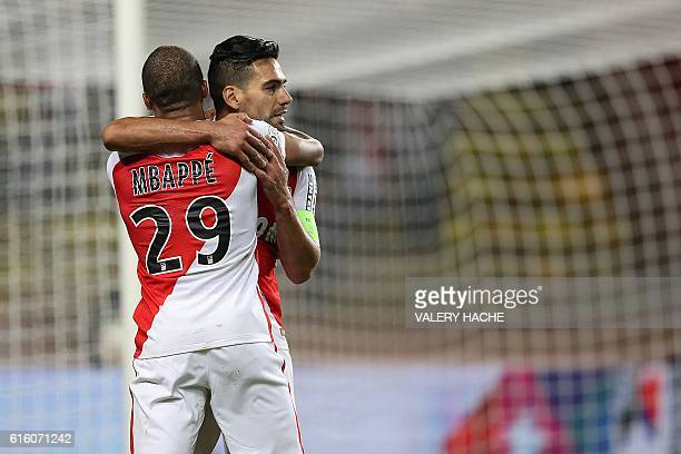 Monaco's Colombian forward Radamel Falcao celebrates with French forward Kylian Mbappe after scoring a goal during the French L1 football match...