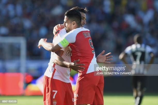 Monaco's Colombian forward Radamel Falcao celebrates with Monaco's Moroccan midfielder Nabil Dirar after scoring a goal during the French L1 football...