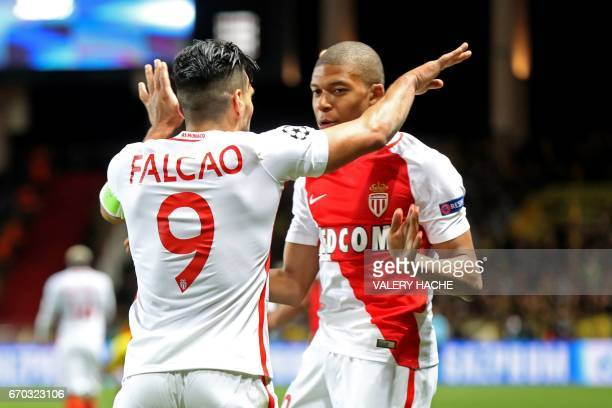 Monaco's Colombian forward Radamel Falcao celebrates with Monaco's French forward Kylian Mbappe Lottin after scoring a header during the UEFA...