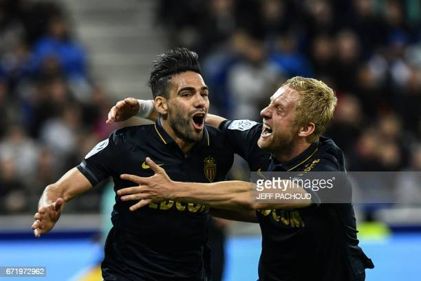 Monaco's Colombian forward Radamel Falcao celebrates with Monaco's Polish defender Kamil Glik during the French L1 football match Olympique Lyonnais...