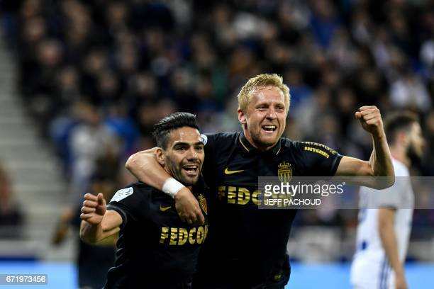Monaco's Colombian forward Radamel Falcao celebrates with Monaco's Polish defender Kamil Glik during the French L1 football match Olympique Lyonnais...