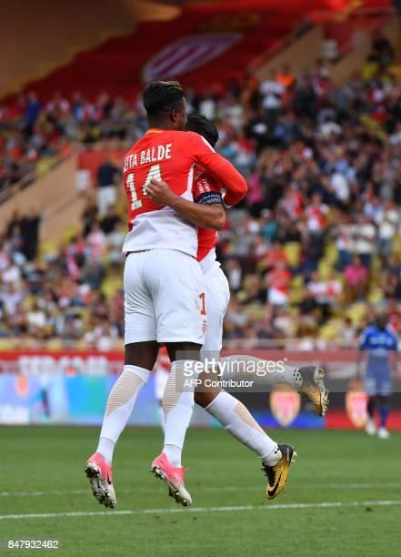 Monaco's Colombian forward Radamel Falcao celebrates with Monaco's Spanish forward Keita Balde after scoring his second goal during the French L1...