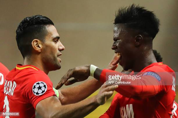 Monaco's Colombian forward Radamel Falcao celebrates with Monaco's Senegalese forward Keita Balde after opening the scoring during the UEFA Champions...