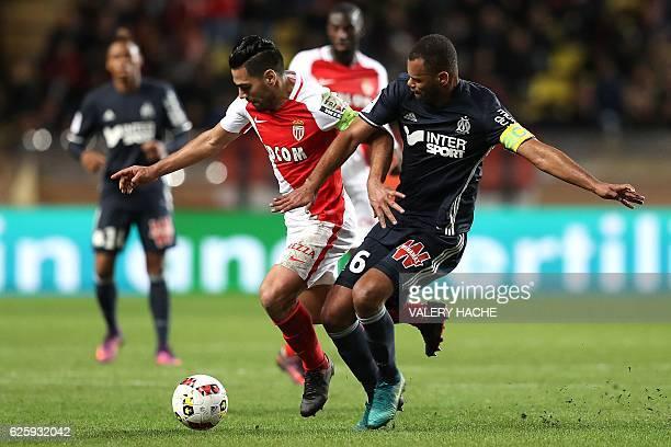 Monaco's Colombian forward Radamel Falcao challenges Marseille's Portuguese defender Jorge Pires Da Fonseca Rolando during the French L1 football...