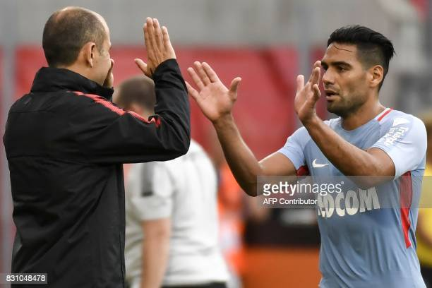 Monaco's Colombian forward Radamel Falcao claps hands with Monaco's Portuguese coach Leonardo Jardim as he leaves the field during the French L1...