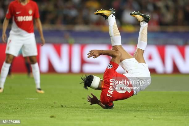 Monaco's Colombian forward Radamel Falcao falls down during the UEFA Champions League Group G football match AS Monaco FC vs FC Porto on September 26...