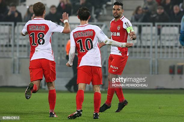 Monaco's Colombian forward Radamel Falcao ic congratulated by teammates after scoring a goal during the French L1 football match Bordeaux vs Monaco...