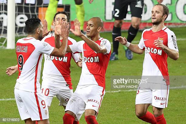 Monaco's Colombian forward Radamel Falcao is congratulated by teammates after scoring a goal during the French L1 football match Monaco vs Nancy on...