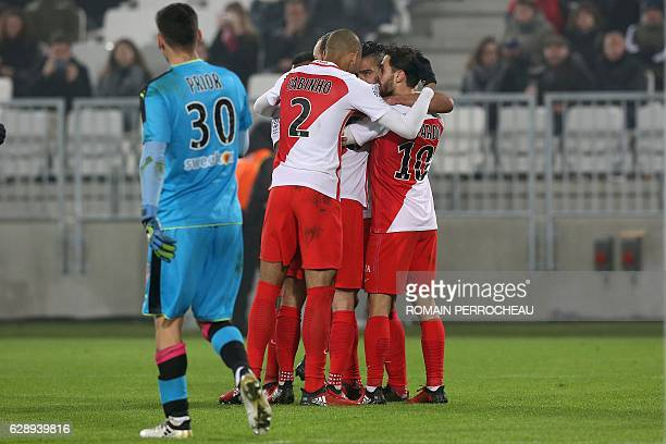 Monaco's Colombian forward Radamel Falcao is congratulated by teammates after scoring a goal during the French L1 football match Bordeaux vs Monaco...