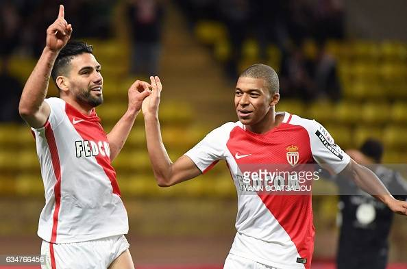 Monaco's Colombian forward Radamel Falcao is congratulated by his teammate Kylian Mbappe Lottin after scoring a goal during the French Ligue 1...