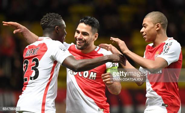 Monaco's Colombian forward Radamel Falcao is congratulated by his teammates including Kylian Mbappe Lottin after scoring a goal during the French...