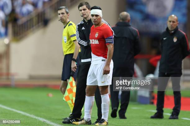 Monaco's Colombian forward Radamel Falcao looks on with a bandaid on the head during the UEFA Champions League Group G football match AS Monaco FC vs...