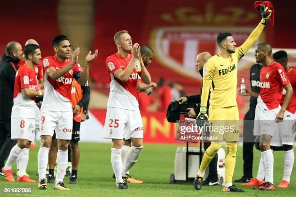 Monaco's Colombian forward Radamel Falcao Monaco's Polish defender Kamil Glik and Monaco's Croatian goalkeeper Danijel Subasic react at the end of...