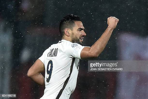 Monaco's Colombian forward Radamel Falcao raises his fist as he celebrates after scoring during the French L1 football match between Lorient and...
