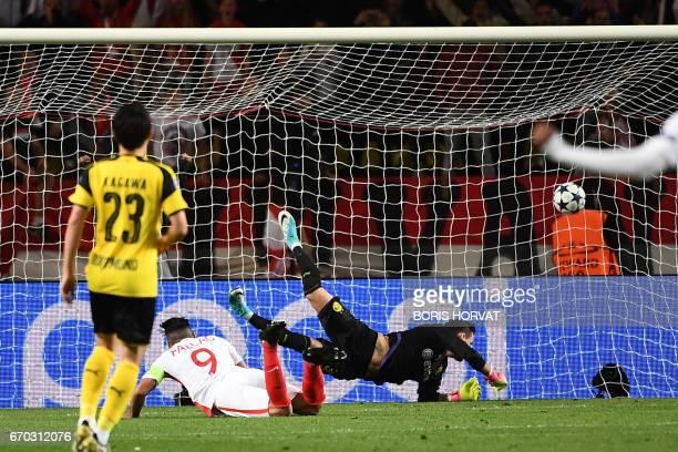 Monaco's Colombian forward Radamel Falcao scores a header during the UEFA Champions League 2nd leg quarterfinal football match AS Monaco v BVB...