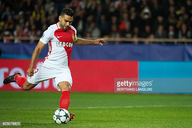 Monaco's Colombian forward Radamel Falcao shoots a penalty kick during the UEFA Champions League group E football match AS Monaco and Tottenham...