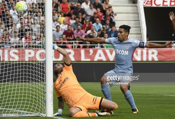 TOPSHOT Monaco's Colombian forward Radamel Falcao shoots and scores against Dijon's French goalkeeper Baptiste Reynet during the French Ligue 1...