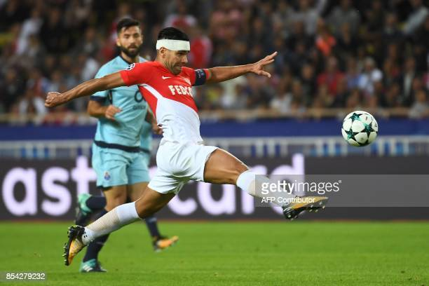 Monaco's Colombian forward Radamel Falcao shoots on goal during the UEFA Champions League Group G football match AS Monaco FC vs FC Porto on...