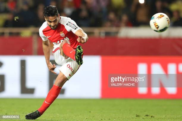 Monaco's Colombian forward Radamel Falcao shoots the ball to score a goal during the French L1 football match Monaco vs Dijon on April 15 2017 at the...