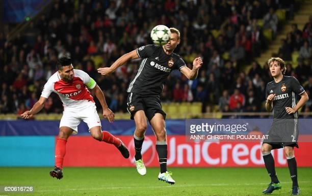 Monaco's Colombian forward Radamel Falcao vies for the ball with CSKA Moscow's defender Aleksei Berezutski and CSKA Moscow's Brazilian defender Mario...