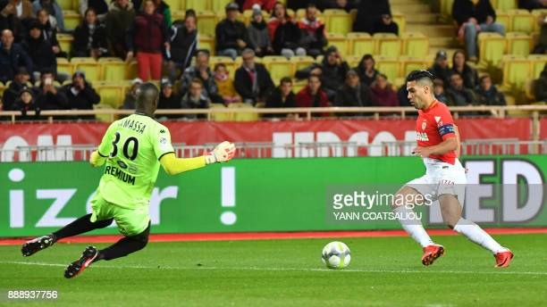 Monaco's Colombian forward Radamel Falcao vies for the ball with Troyes' Malian goalkeeper Mamadou Samassa during the French L1 football match AS...