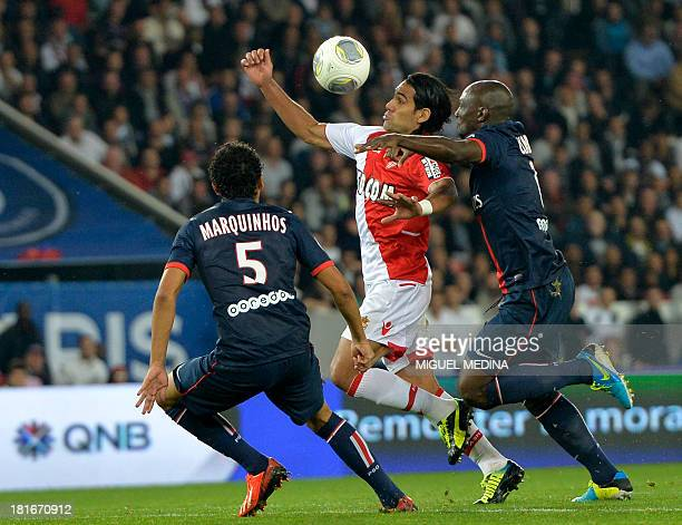 Monaco's Colombian forward Radamel Falcao vies with Paris SaintGermain's playersduring the French L1 football match between Paris SaintGermain and AS...
