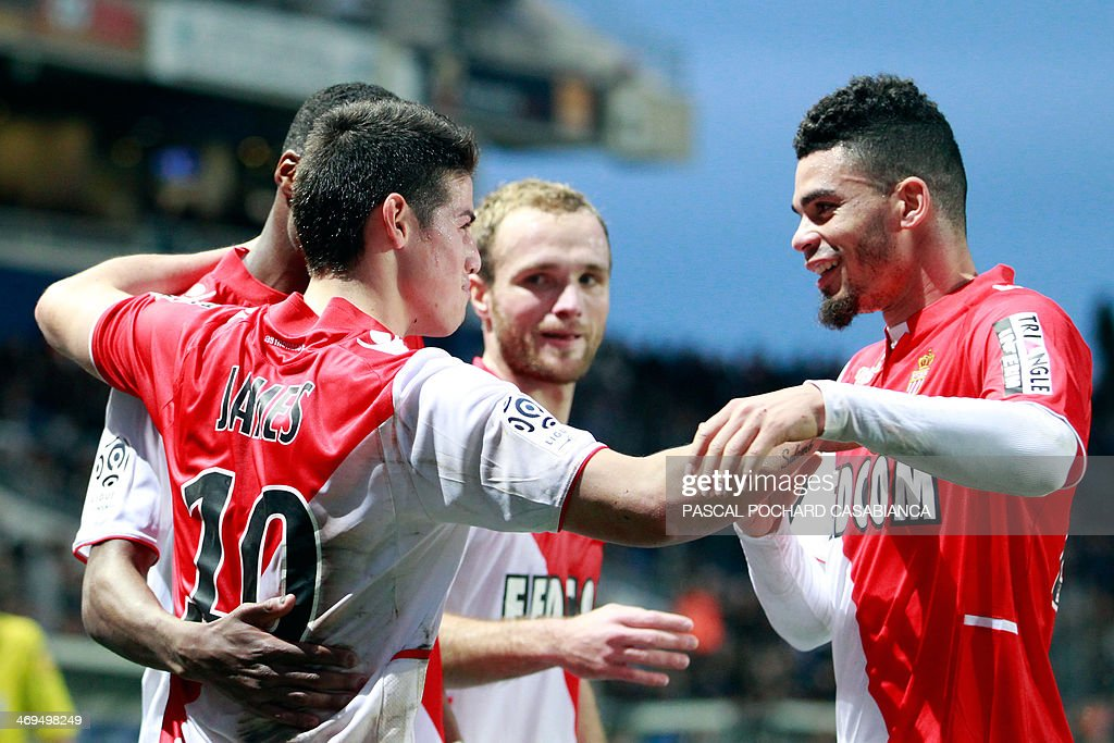 Monaco's Colombian midfielder James Rodriguez (L) is congratulated by teammate French forward Emmanuel Riviere after scoring a goal during the French L1 football match Bastia (SCB) against Monaco (ASM) in the Armand Cesari stadium in Bastia, Corsica, on February 15 , 2014.