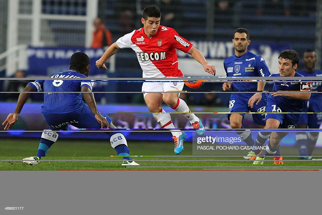 Monaco's Colombian midfielder James Rodriguez vies with Bastia's Ivory Coast midfielder Romaric Ndri Koffi (L) during the French L1 football match Bastia (SCB) against Monaco in the Armand Cesari stadium in Bastia, Corsica, on February 15 , 2014. AFP PHOTO / PASCAL POCHARD-CASABIANCA