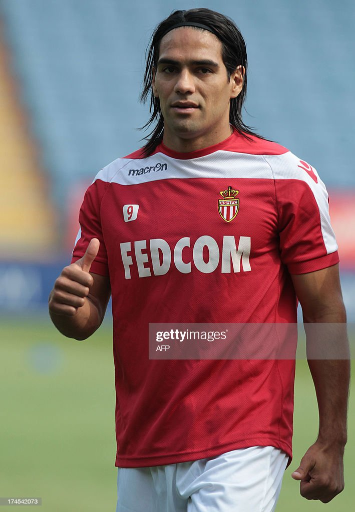 AS Monaco's Colombian striker Radamel Falcao gives the thumbs-up to fans during warm-up ahead of the pre-season friendly football match between Leicester City and AS Monaco at the King Power Stadium in Leicester, central England on July 27, 2013.