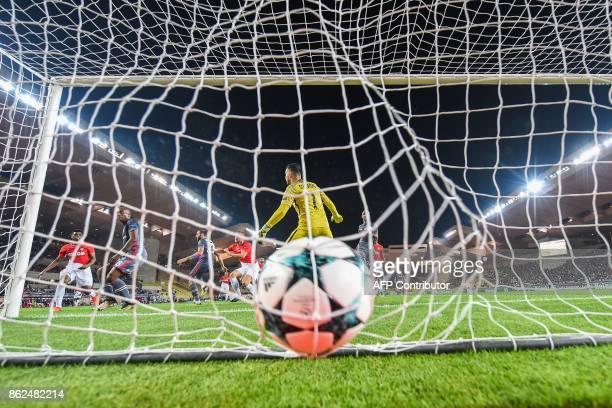 Monaco's Croatian goalkeeper Danijel Subasic fails to stop an equalizing goal by Besiktas' forward Cenk Tosun during the UEFA Champions League group...