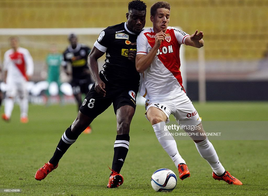 Monaco's Croatian midfielder Mario Pasalic challenges Angers' Ivorian defender Ismael Traore during the French L1 football match between Monaco and...