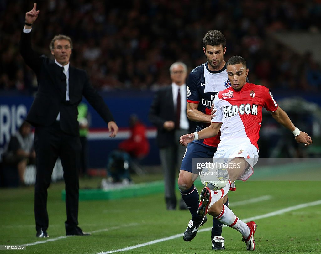 Monaco's defender Fabio Tavares (R) vies with Paris Saint-Germain's Italian midfielder Thiago Motta in frontParis Saint-Germain's coach Laurent Blanc during the French L1 football match between Paris Saint-Germain and AS Monaco at the Parc des Princes Stadium in Paris on September 22, 2013. The match ended in a 1-1 draw.