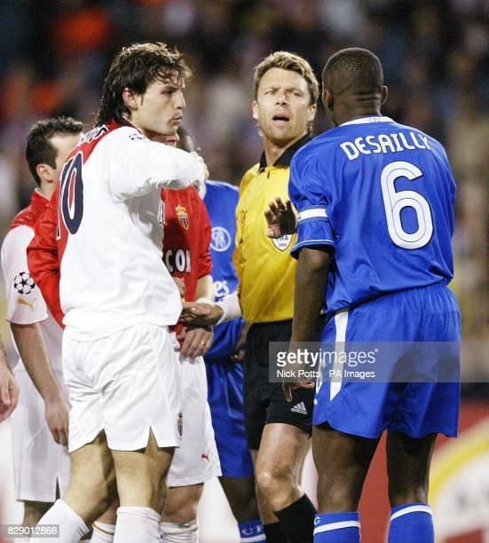 Monaco's Fernando Morientes and Chelsea's Marcel Desailly with referee Urs Meier following an incident in which both players clashed during the UEFA...