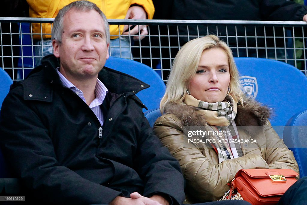 Monaco's football club Russian vice-president Vadim Vasilyev (L) and an unidentified woman attend the French L1 football match Bastia (SCB) vs Monaco (ASM) at the Armand Cesari stadium in Bastia, Corsica island, on February 15 , 2014. AFP PHOTO / PASCAL POCHARD-CASABIANCA