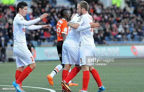 Monaco's France forward Valere Germain is congratulated by teammates after scoring during the French L1 football match between Lorient and Monaco on...