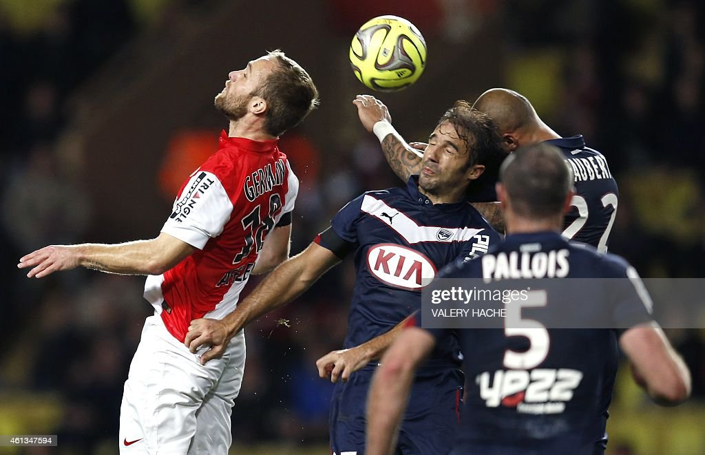 Monaco's France forward Valere Germain (R) vies with Bordeaux's French defender <a gi-track='captionPersonalityLinkClicked' href=/galleries/search?phrase=Marc+Planus&family=editorial&specificpeople=708262 ng-click='$event.stopPropagation()'>Marc Planus</a> (C) and Bordeaux's French defender <a gi-track='captionPersonalityLinkClicked' href=/galleries/search?phrase=Julien+Faubert&family=editorial&specificpeople=600452 ng-click='$event.stopPropagation()'>Julien Faubert</a> (R) during the French L1 football between match Monaco (ASM) and Bordeaux (GDB) on january 11, 2015 at the Louis II Stadium in Monaco.