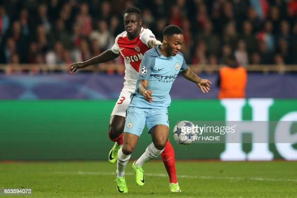 Monaco's French defender Benjamin Mendy challenges Manchester City's English midfielder Raheem Sterling during the UEFA Champions League round of 16...