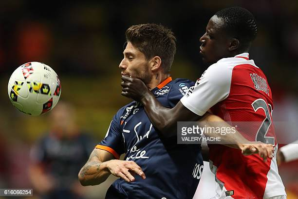 TOPSHOT Monaco's French defender Benjamin Mendy challenges Montpellier's French midfielder Paul Lasne during the French L1 football match between AS...