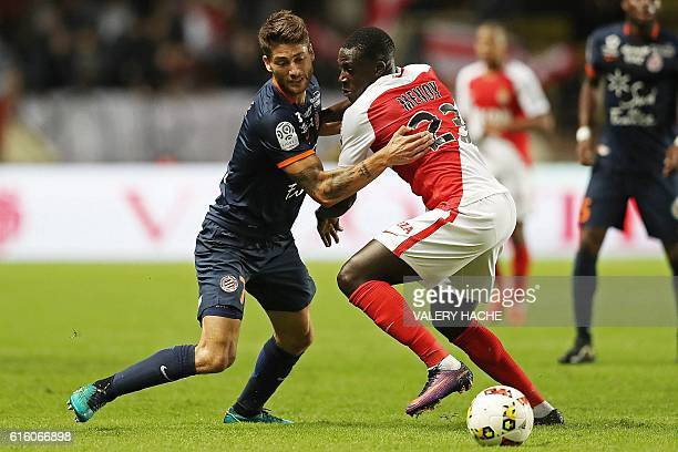 Monaco's French defender Benjamin Mendy challenges Montpellier's French midfielder Paul Lasne during the French L1 football match between AS Monaco...