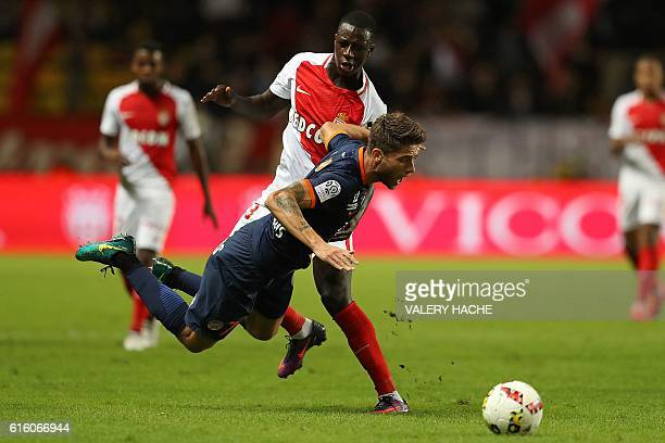 TOPSHOT Monaco's French defender Benjamin Mendy fouls Montpellier's French midfielder Paul Lasne during the French L1 football match between AS...