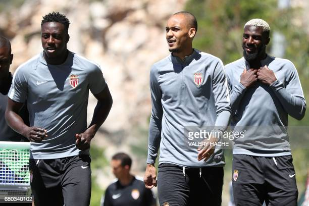 Monaco's French defender Benjamin Mendy Monaco's Brazilian defender Fabinho and Monaco's French midfielder Tiemoue Bakayoko arrive for a training...