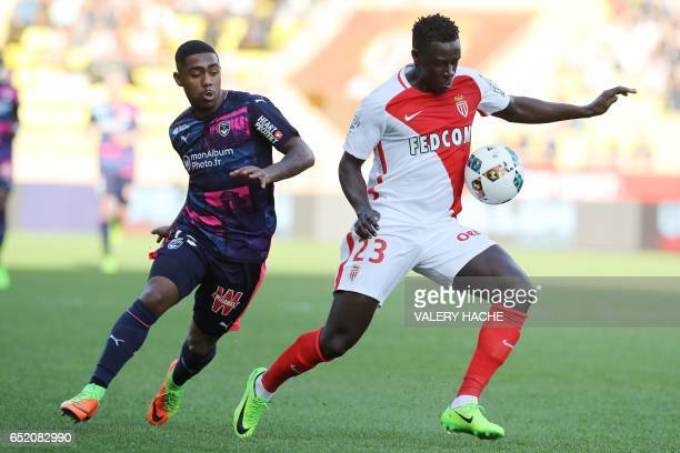 Monaco's French defender Benjamin Mendy vies with Bordeaux's Brazilian forward Malcom during the French L1 football match Monaco vs Bordeaux on March...